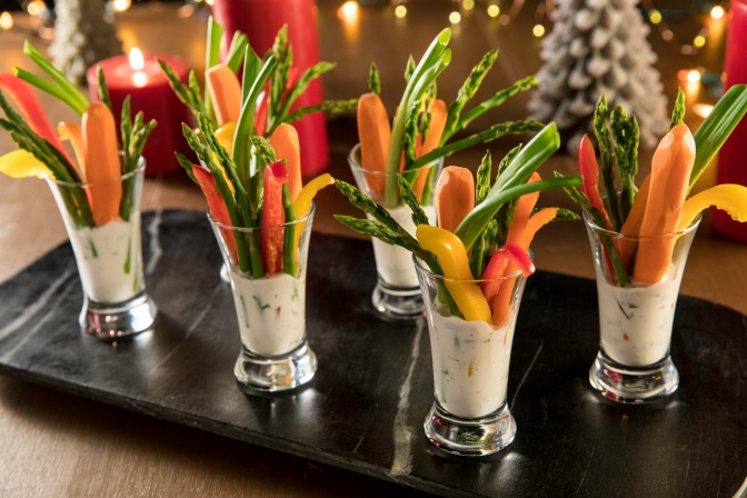 Serve a crisp, fresh assortment of veggies displayed in individual-size shot glasses with buttermilk-herb dip as a fresh & healthy appetizer at your holiday party. Double dipping encouraged!