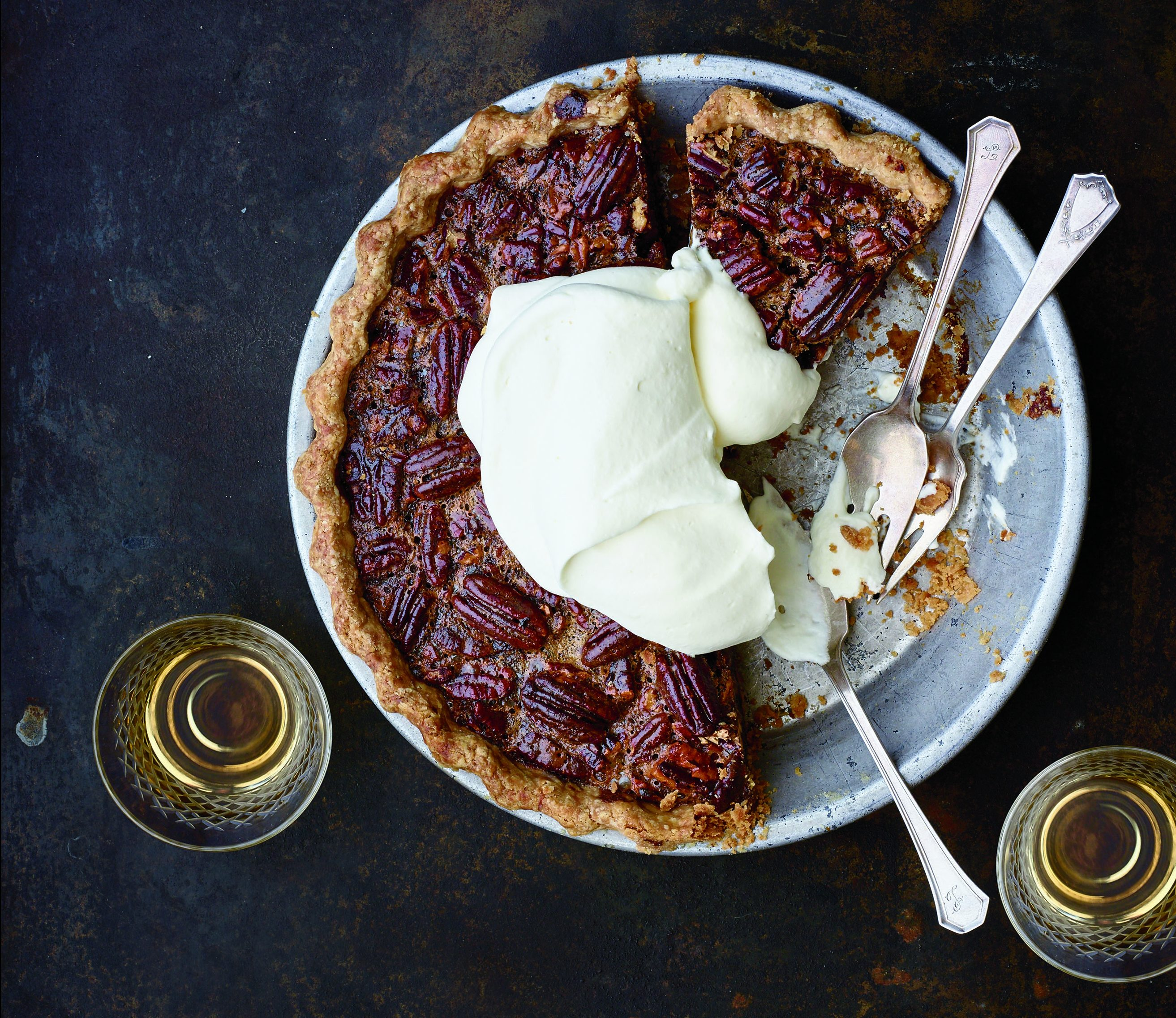 This filling is swirled with toasty brown butter and studded with rich and chewy dates cooked in espresso, which helps cut the sweetness you expect in most pecan pies.