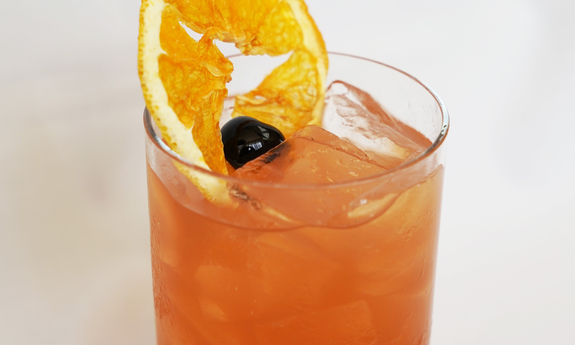The delicious fall-inspired drink is concocted by blending perfectly aged Bourbon, Luxardo Apricot, fresh lemon juice, Fee Bros Old Fashion bitters and garnished with a dehydrated orange wheel and black cherry.