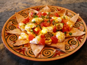 An easy and nutritious way to create a quick nibble, Downtown Nachos offer a full plate of delicious flavor that delivers one chip at a time!