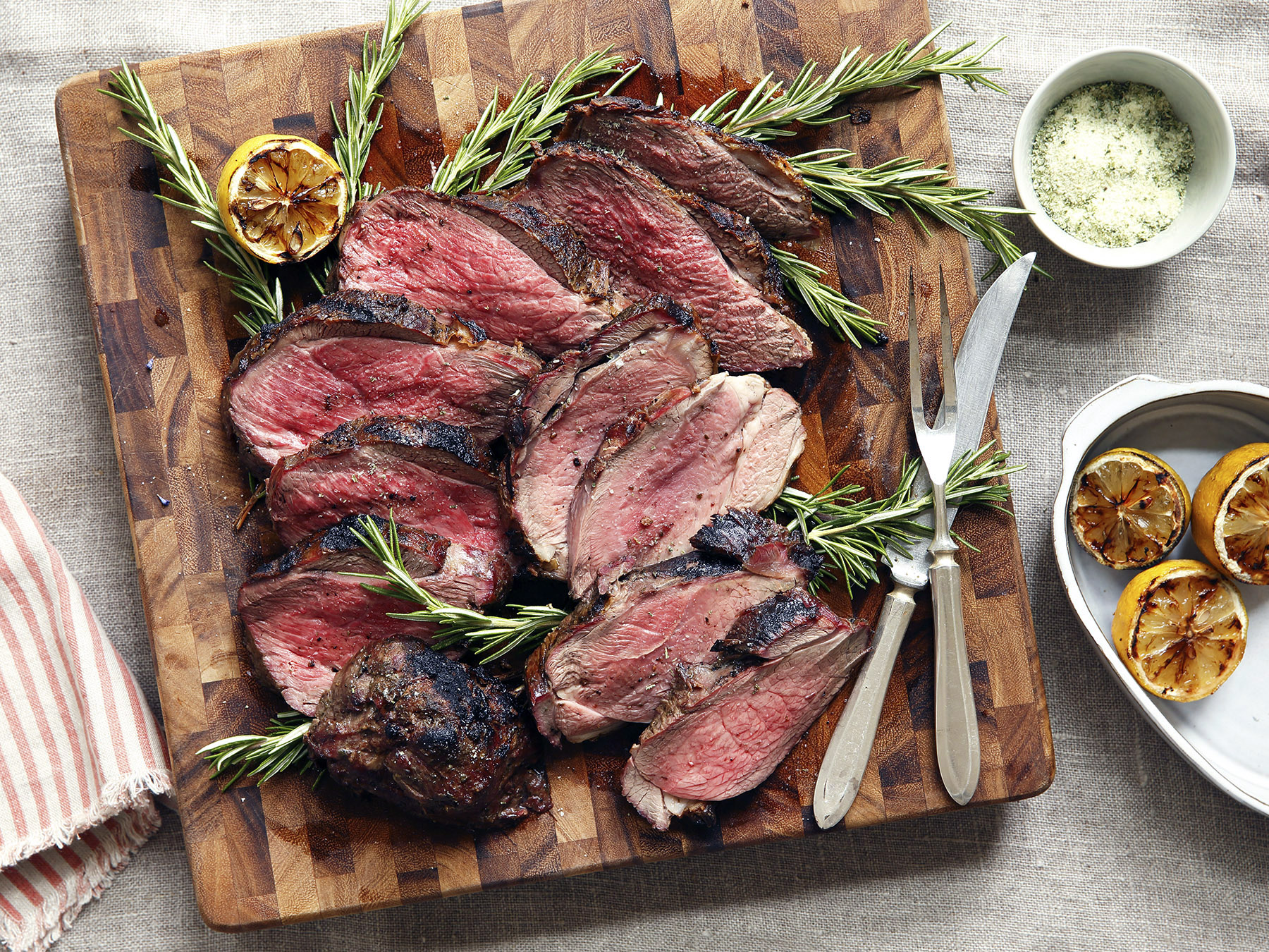 Ready in under an hour, this Butterflied Leg of Lamb is generously seasoned with a homemade rosemary sea salt and served with a charred lemon for squeezing.