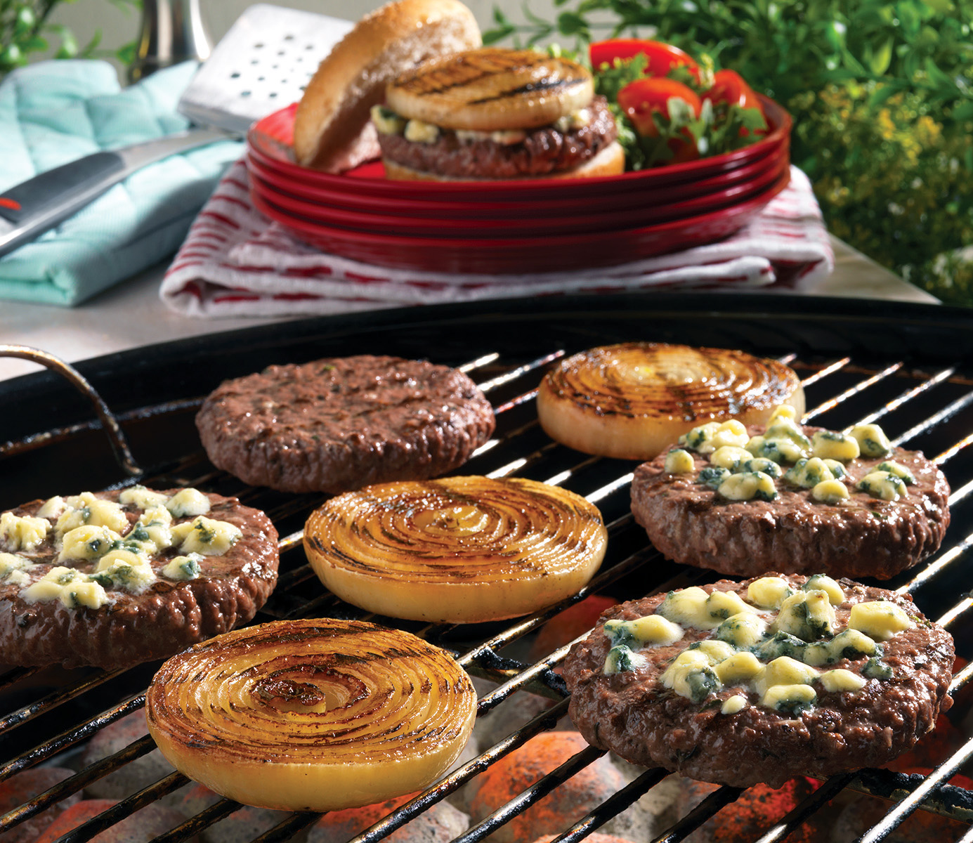 This recipe for Grilled Onion Cheeseburgers gives you all of the comforting feelings of a classic cheeseburger with the added twist of flavorful grilled onions, garlic, and your favorite crumbly cheese.