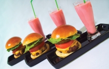 This Memorial Day, consider serving one of America's favorite foods, bacon cheddar cheeseburgers (mini-style) and classic Strawberry Milkshakes.