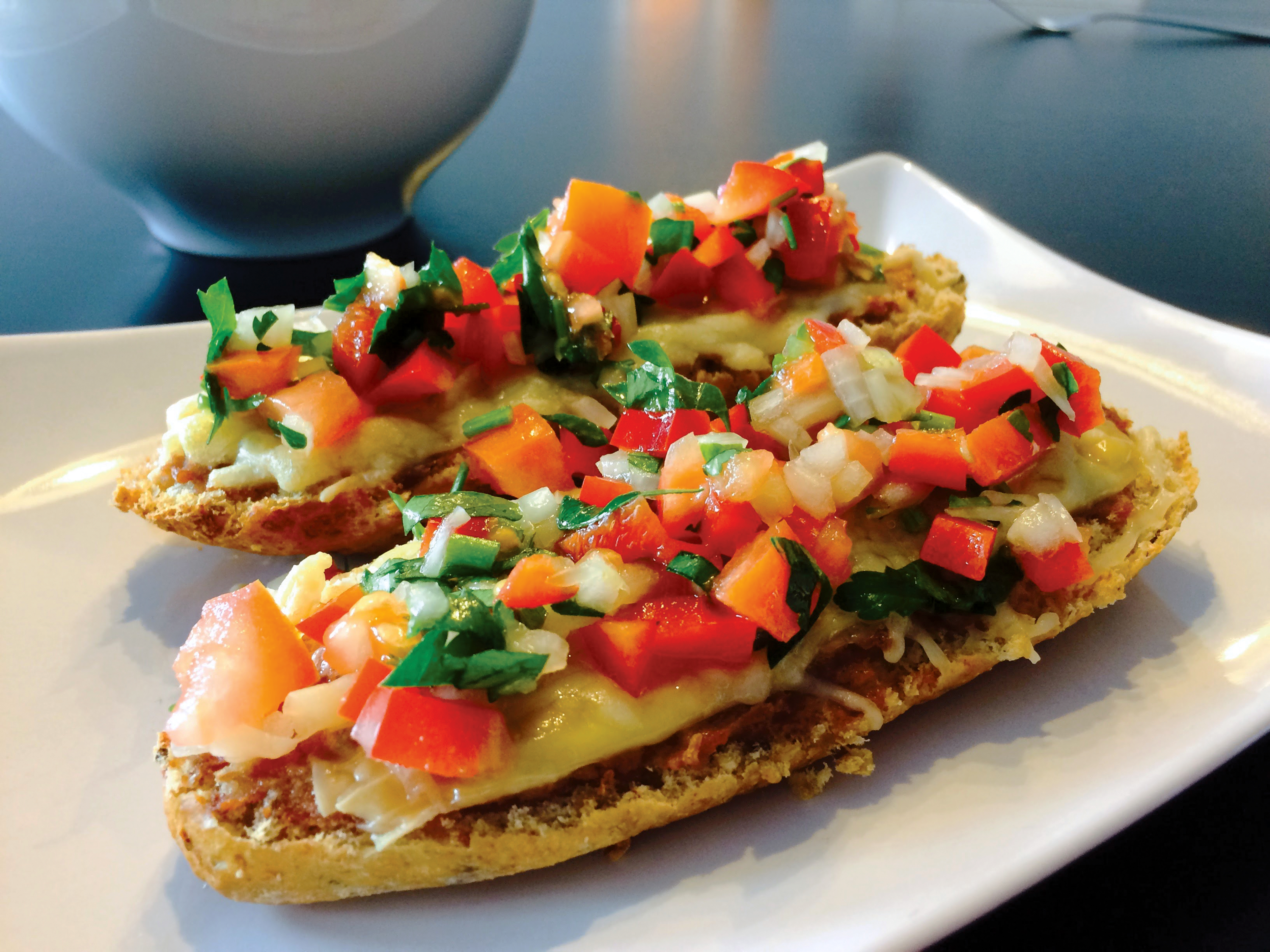 A Mollete is a traditional sandwich of Mexico that is typically served open-faced. It's a comforting dish that can be compared to the American grilled cheese.