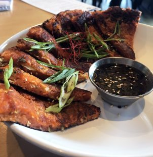 We had the pleasure of tasting a variety of dishes, complimentary of HOMES, including the chicken wings; both the Sichuan dry rub and Korean BBQ; a Kimchi Flight, which is a trio of seasonal house kimchi; a daily special of Kimchi Pancakes.