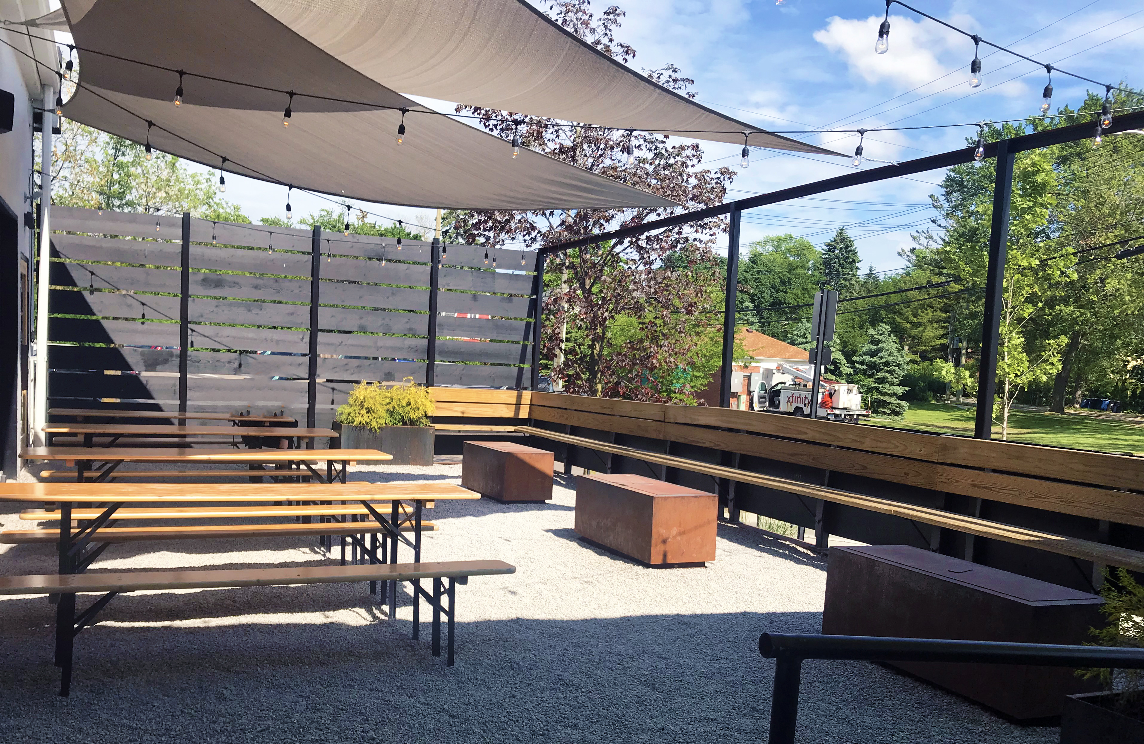 When you approach HOMES Brewery for the first time, the first thing you notice is the two large outdoor patios that sit in front. The building looks approachable and casual, yet vibrant and inviting with pops of lime green, orange and blue sprinkled across the front.