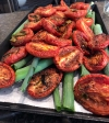 A tray of beautifully roasted tomatoes and herbs served at Cornman Farms.