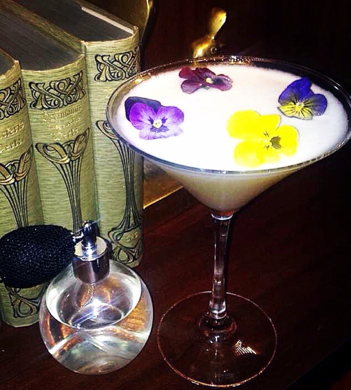 "The ""Bee's Sneeze"" cocktail at The Bar at the Spectator Hotel combines an egg-white base with Orange Blossom & Rosewater, Ransom Old Tom Gin, Fresh Lemon Juice and Lavender-infused Charleston Bees Honey - making it the ideal drink to sip on after a beautiful summer day."