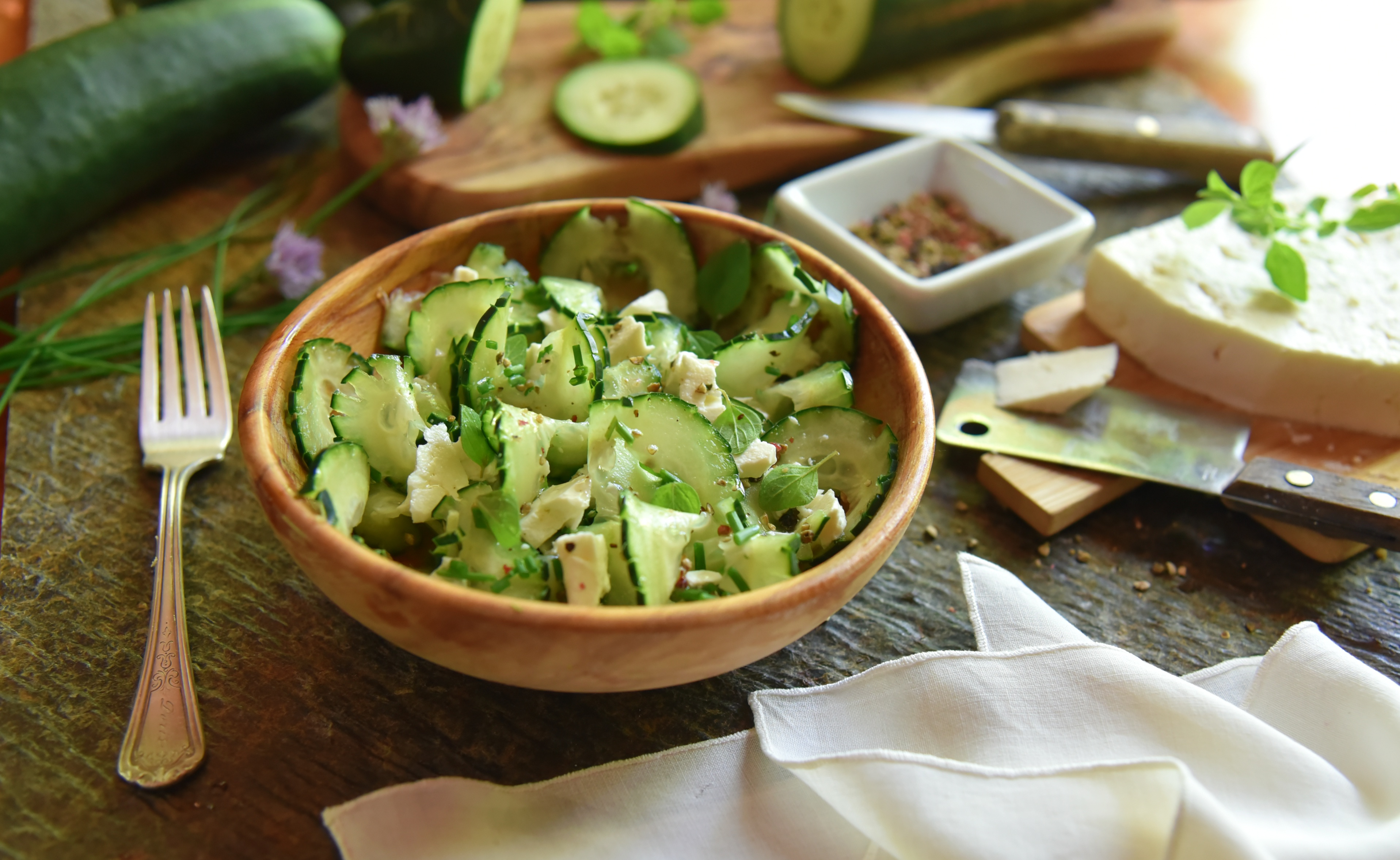 A refreshing, fresh, cucumber salad made with chives, feta cheese, avocado oil, and freshly-cracked peppercorns!