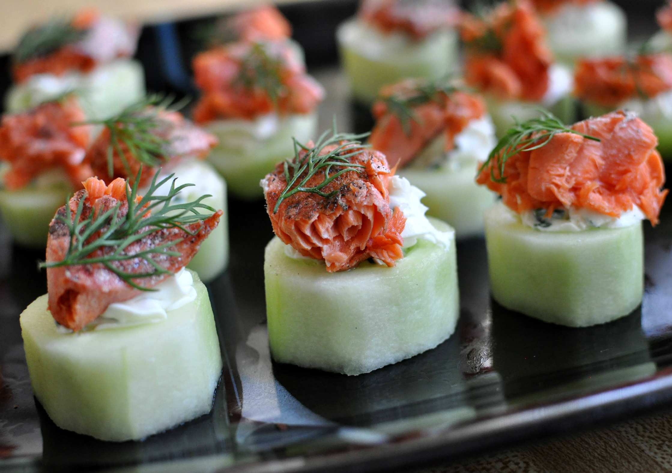 A refreshing twist on the traditional bagel and lox, these smoked salmon bites are served on a hollowed out piece of fresh cucumber!