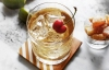 Pour vodka and ginger ale into a rocks glass filled with ice and stir briefly. Squeeze fresh lime juice on top. Garnish with a cherry.
