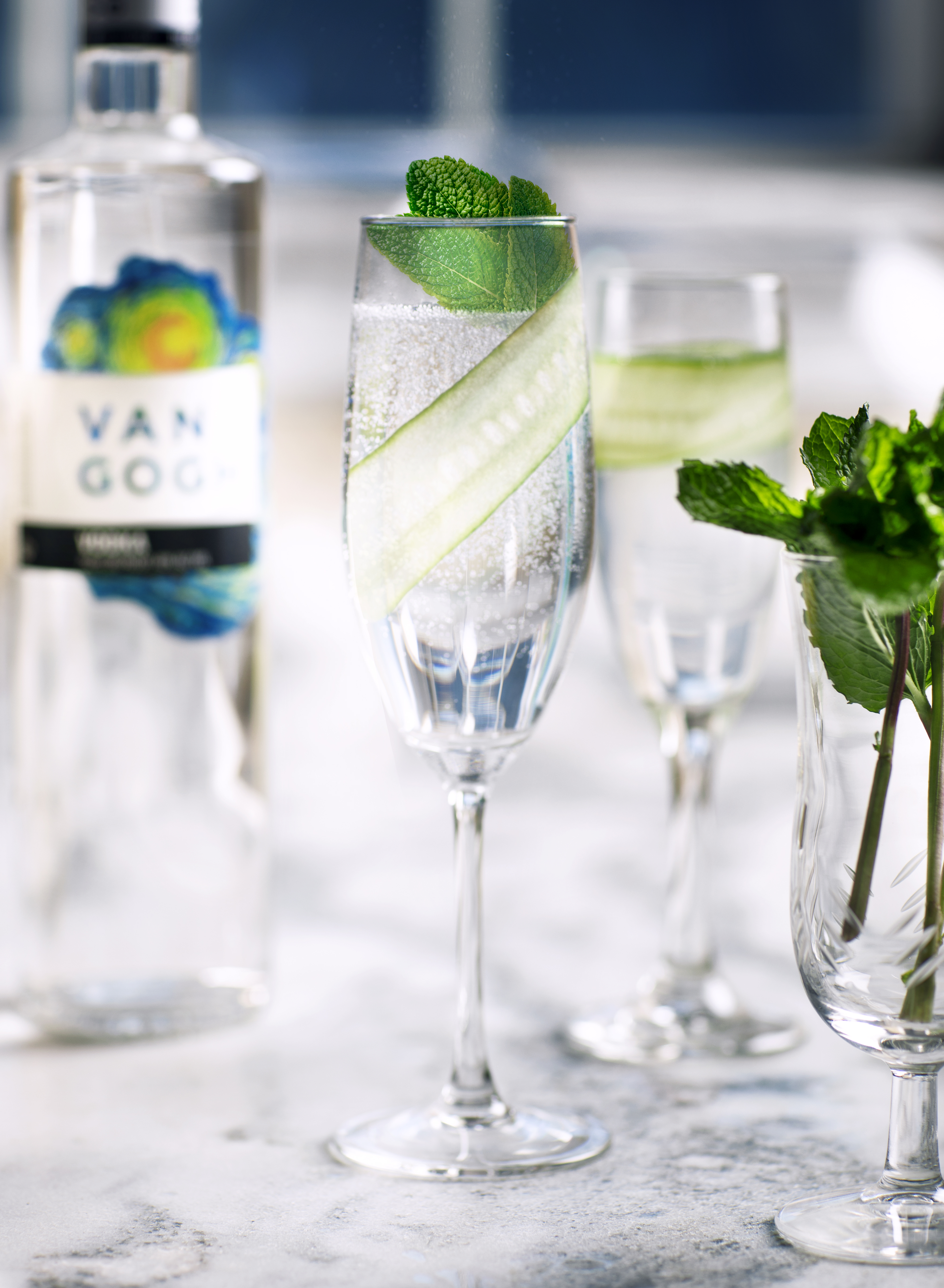 Muddle cucumber and mint in the sour mix. Add Van Gogh Vodka with ice and shake well. Strain into a chilled martini glass or flute, top with club soda. Garnish with a long thin strip of cucumber.