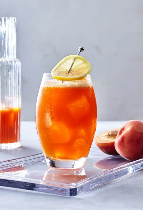 The georgia cocktail made with ciroc peach vodka, lime juice, simple syrup and carrot juice.