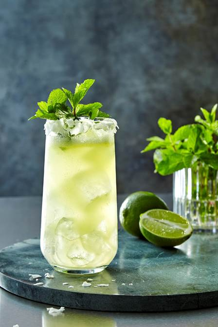 A refreshing summer cocktail made with Ciroc Summer Colada, lime juice, pineapple juice, coconut water and simple syrup.