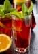 Citrus basil spiked sweet tea made with water, tea, sugar, lemons, oranges, rum and basil.