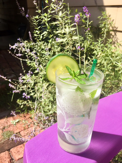The summer patio sipper is made with gin, lime juice, blackberry cucumber lacroix and elderflower liquor, then garnished with fresh cucumber, mint and lavender.