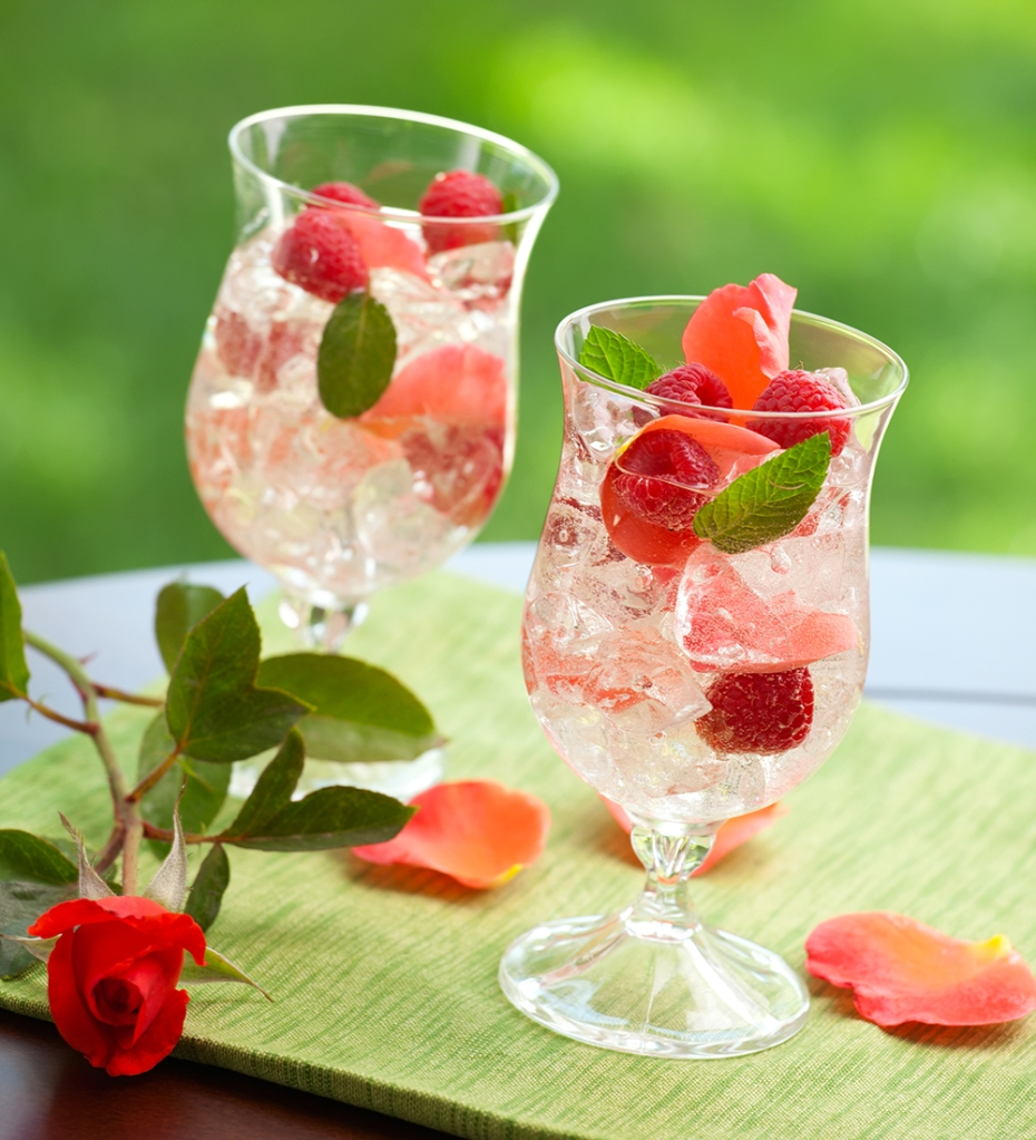 A French Rose Sangria made with rose wine, Grand Marnier, club soda and raspberries.