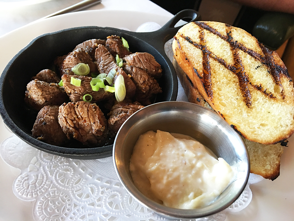 Start with the Steak Bites. They are described as pan seared tenderloin, with garlic aioli, grilled garlic toast—in other words, melt-in-your-mouth delicious. Seriously one of the best appetizers you'll find anywhere.