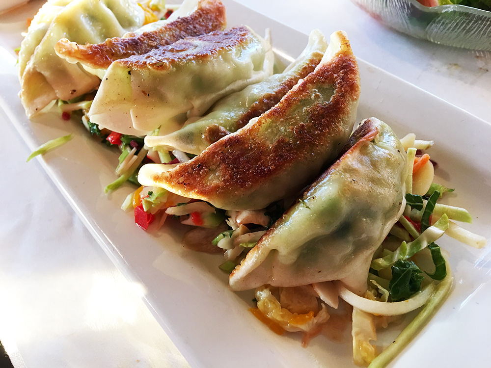 Or, go for the Edamame Pot Stickers, a series of dumplings with Asian slaw, Thai chili, and bulgogi dipping sauce.