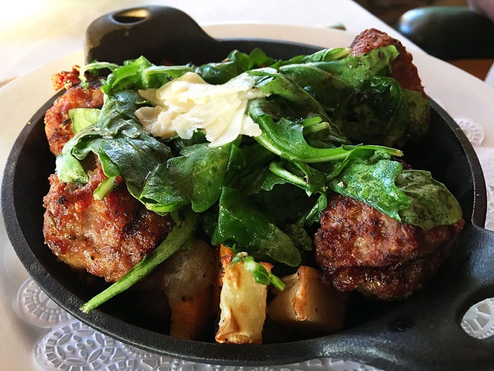 For entrees, we recommend the Skillet Sausage & Potatoes, an excellent and surprising blend of Italian sausage with potatoes and arugula, topped with parmesan.