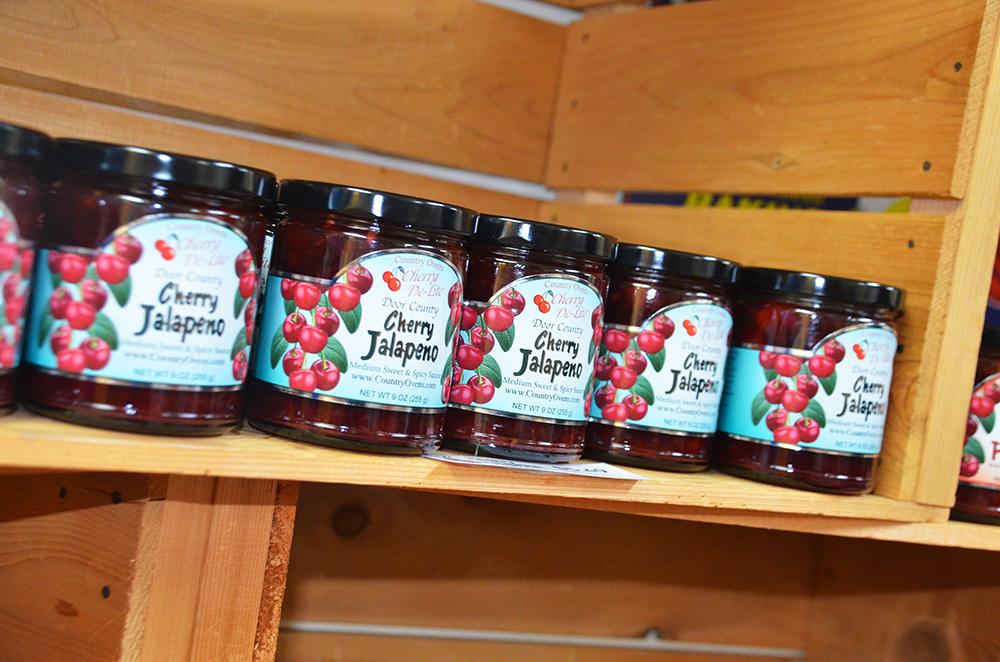 Jars of Cherry Jalapeno Cherry De-Lite line the shelves at the store in Door County, Wisconsin.