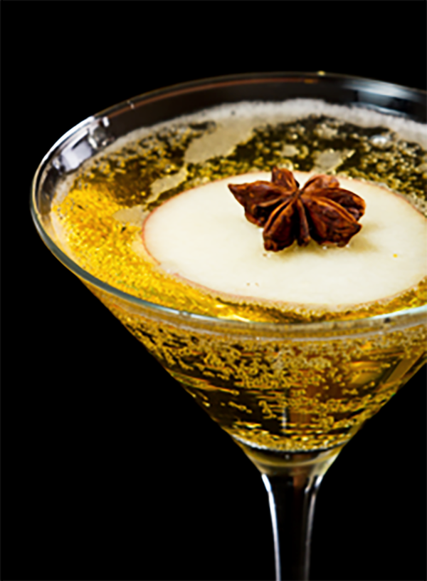 This autumn apple martini is made with apple flavored vodka, light apple juice, club soda, lime and garnished with apple slices.