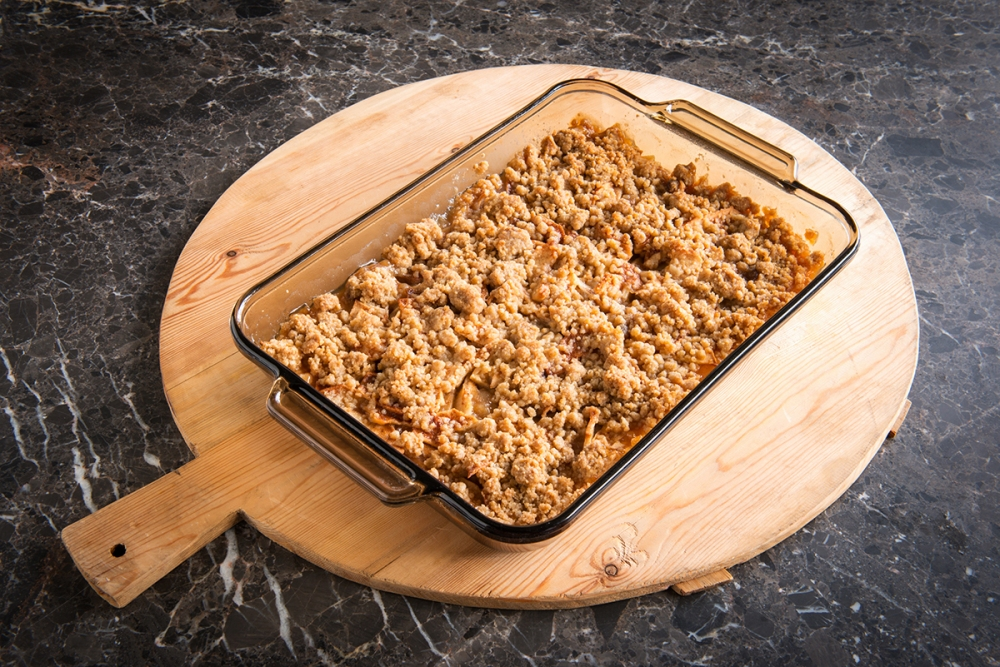 Made with fresh apples, sugar, cinnamon, nutmeg, cardamom and more, this delicious apple crisp won't last long on your table.