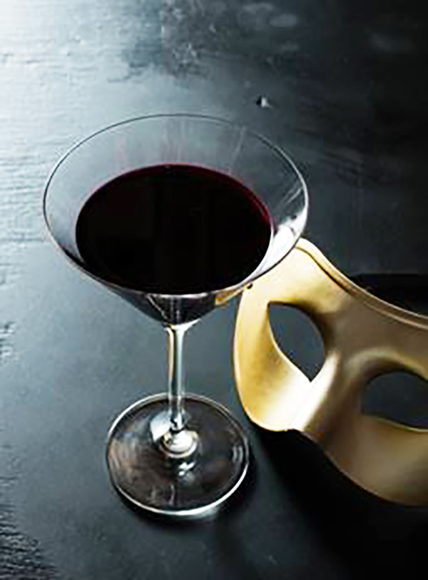 The Absolut Masquerade is made with absolut vodka, black currant juice and chartreuse.