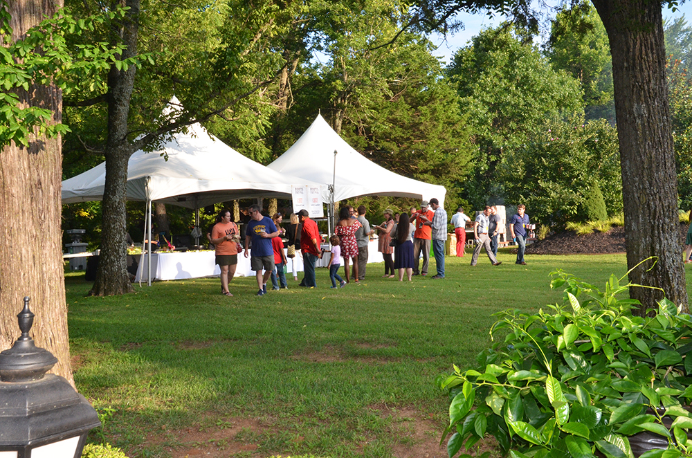 guests at the Fayetteville Roots Festival mingle at the guest chef tents.