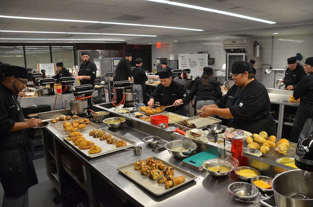 Students working together as part of culinary classes at Brightwater, a center for the study of food in Northwest Arkansas.