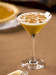 A martini glass filled with a pumpkin spice martini made with cream liqueur, vanilla vodka and pumpkin liqueur.