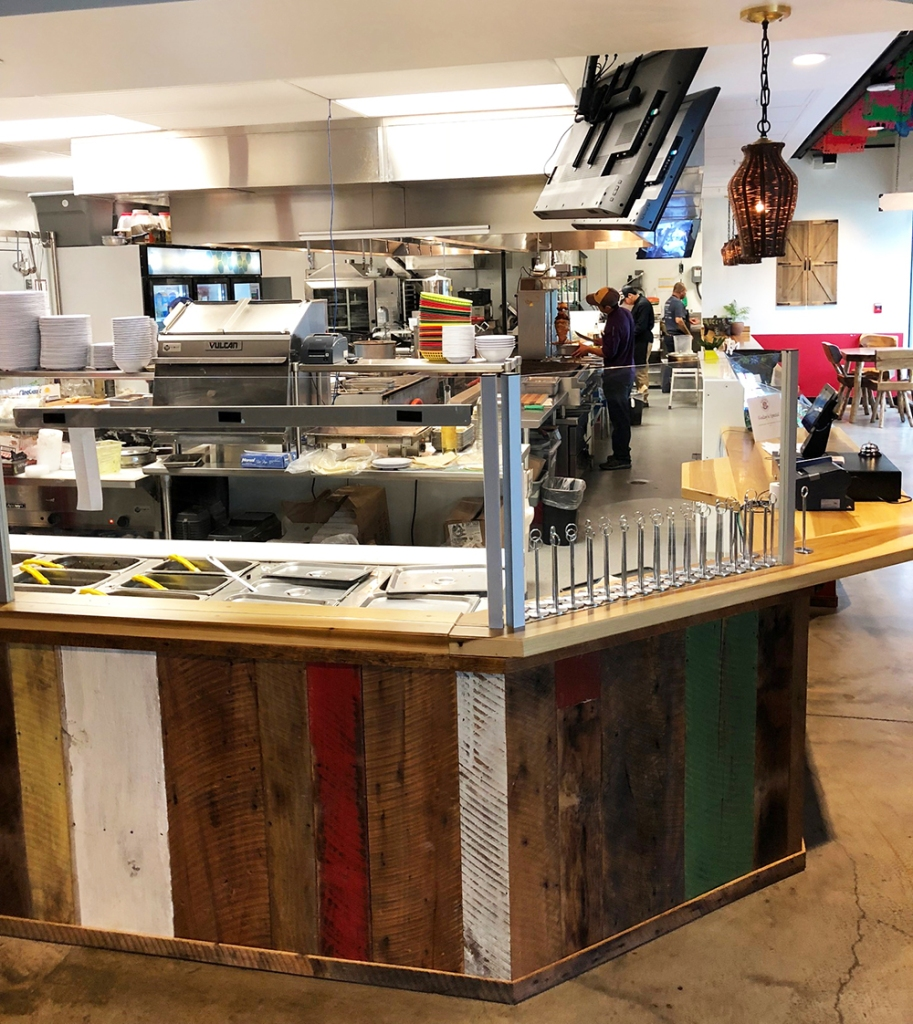 The open kitchen at Yeyos Mexican Grill, part of the 8th Street Market at Bentonville, Arkansas.