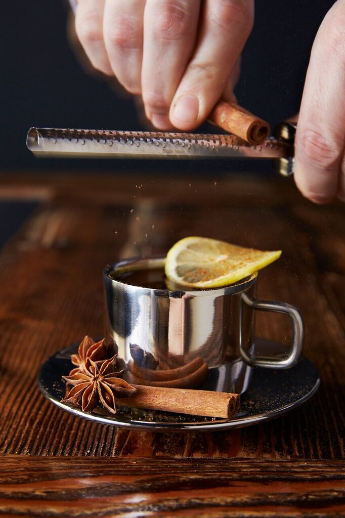 Combine water and demerara sugar. Heat in microwave until sugar dissolves (about 45 seconds). Add Old Monk XXX Indian Rum, a fresh squeeze of lemon juice, and 2 dashes of Bittercube Blackstrap Bitters. Give a few stirs, then garnish with lemon wheel and freshly grated cinnamon over the top.