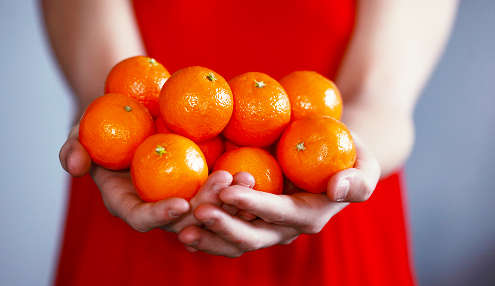 Oranges are often shared during Chinese New Year as a symbol of good fortune.