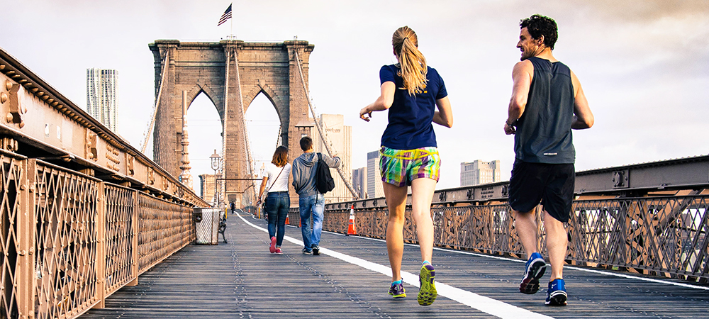 Joggers run across the Brooklyn Bridge in New York City.