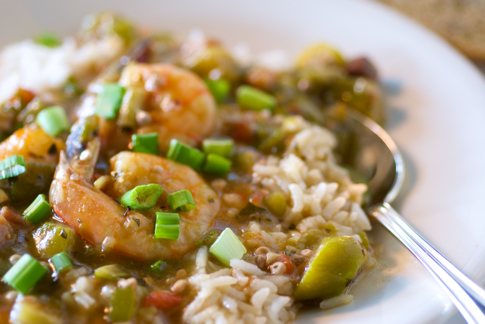 Hearty slow-simmered traditional gumbo served ladled over steamed white rice. Traditionally made with smoked ham, jumbo shrimp, okra, and just a hint of Cajun seasoning for that spicy kick.