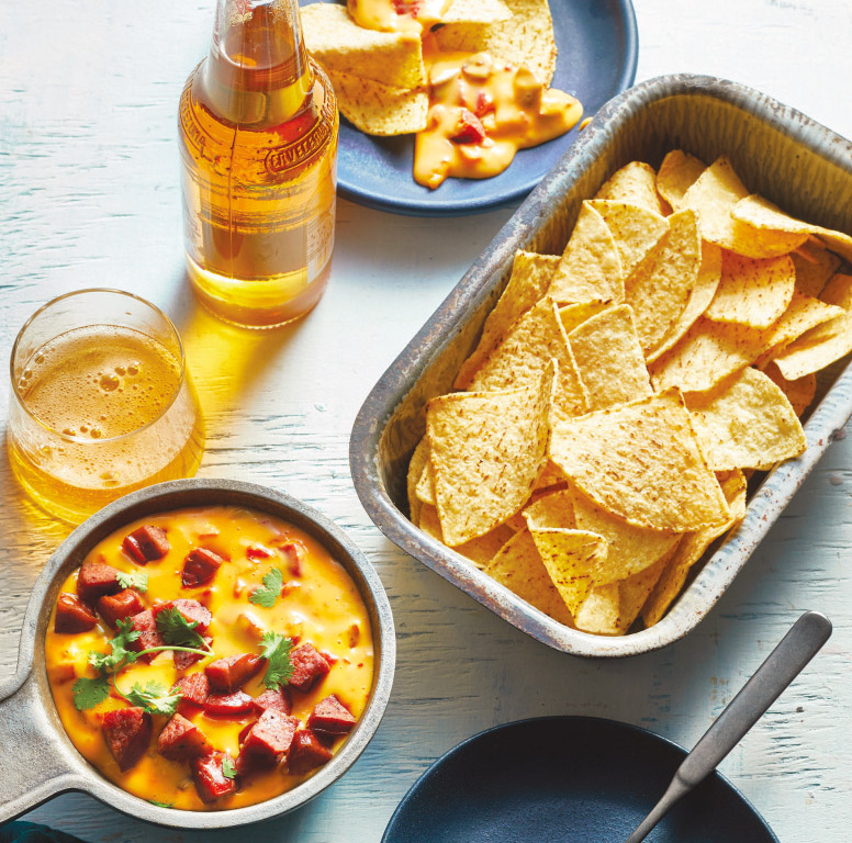 Spicy cheese dip made with sausage, perfect for dipping chips. The recipe comes from Martina McBride's latest cookbook, Martina's Kitchen Mix.