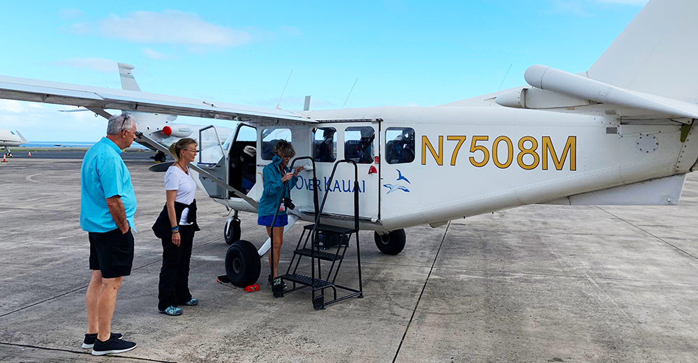 Tourists boarding a small plane as they prepare to tour the Hawaiian islands.