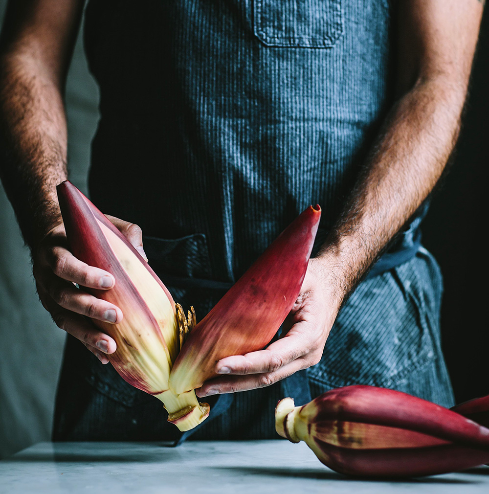 A chef shows readers how to prepare a banana blossom in The Wicked Healthy Cookbook, which extols the virtues and health benefits of a plant-based diet.