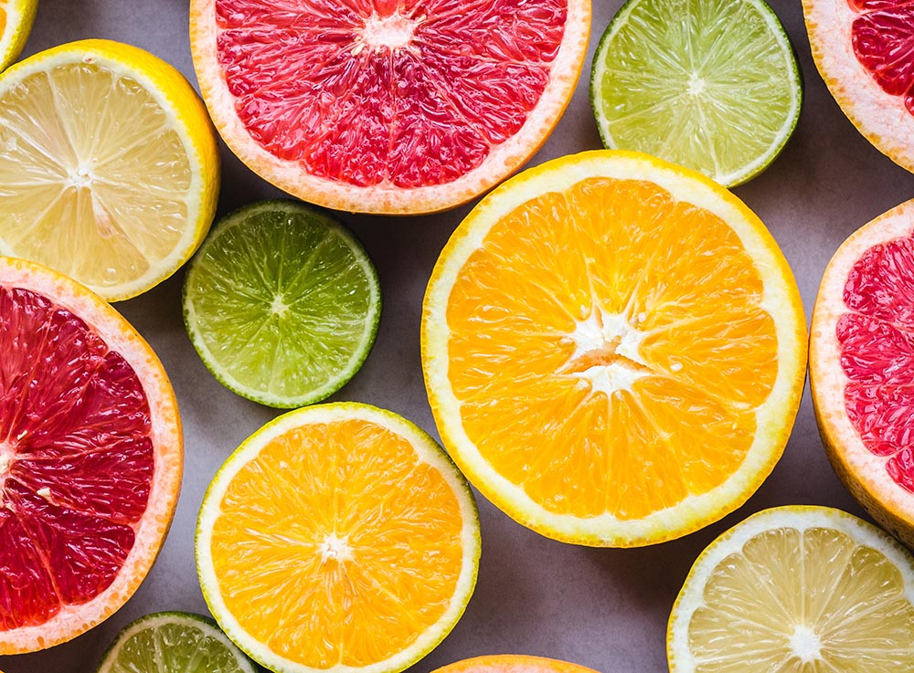 An assortment of fresh, sliced citrus, one of the superfoods featured in the Diabetes Superfoods Cookbook.
