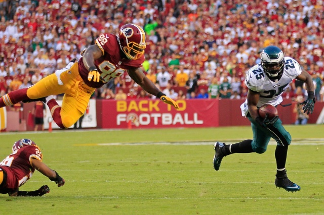 Even a flying Orakpo can't stop McCoy.