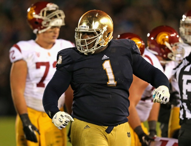 Louis Nix III #1 of the Notre Dame Fighting Irish celebrates near the end of the game against the University of Southern California Trojans at Notre Dame Stadium on October 19, 2013 in South Bend, Indiana. Notre Dame defeated USC 14-10. (Jonathan Daniel - Getty Images)