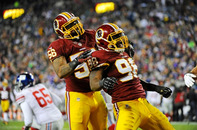 Washington Redskins linebacker Brian Orakpo (right) celebrates a sack. (Brad Mills, USA TODAY Sports)