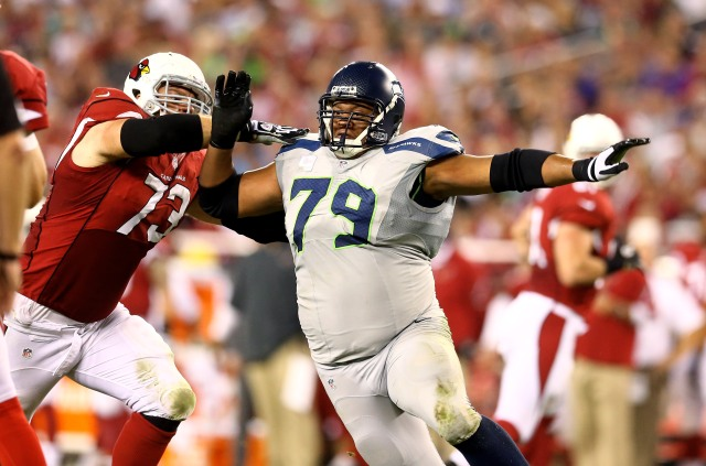 Defensive end Red Bryant epitomizes Seattle's adaptive philosophy.  Credit: Mark J. Rebilas-USA TODAY Sports
