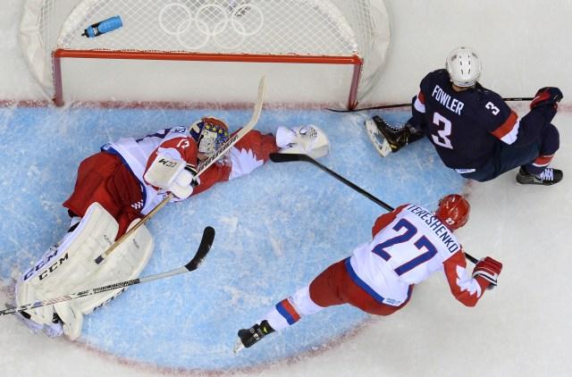 Cam Fowler scores against Russia's Alexei Tereshchenko. (ALEXANDER NEMENOV/Getty Images)