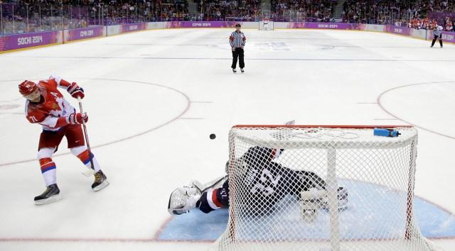 USA goaltender Jonathan Quick stops the last shot by Russia forward Ilya Kovalchuk in a shootout.  (AP Photo/Mark Humphrey)