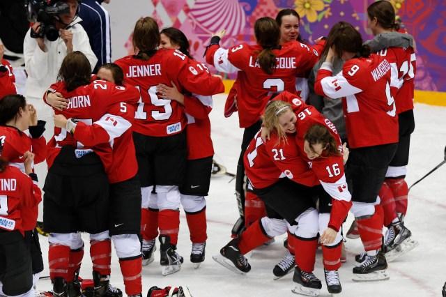 Team Canada celebrates winning gold. (Winslow Townson, USA TODAY Sports)