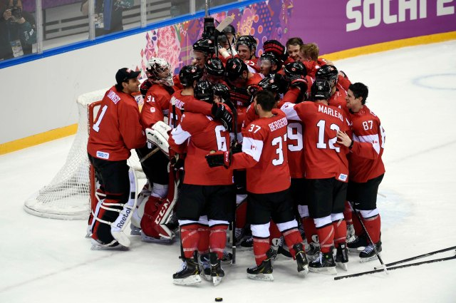 Canada celebrates winning gold in men's hockey at the Sochi Winter Olympics.  (Scott Rovak, USA TODAY Sports)