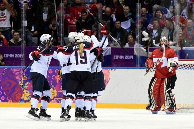 The U.S. women's hockey team celebrates after Meghan Duggan's goal. (Scott Rovak, USA TODAY Sports)