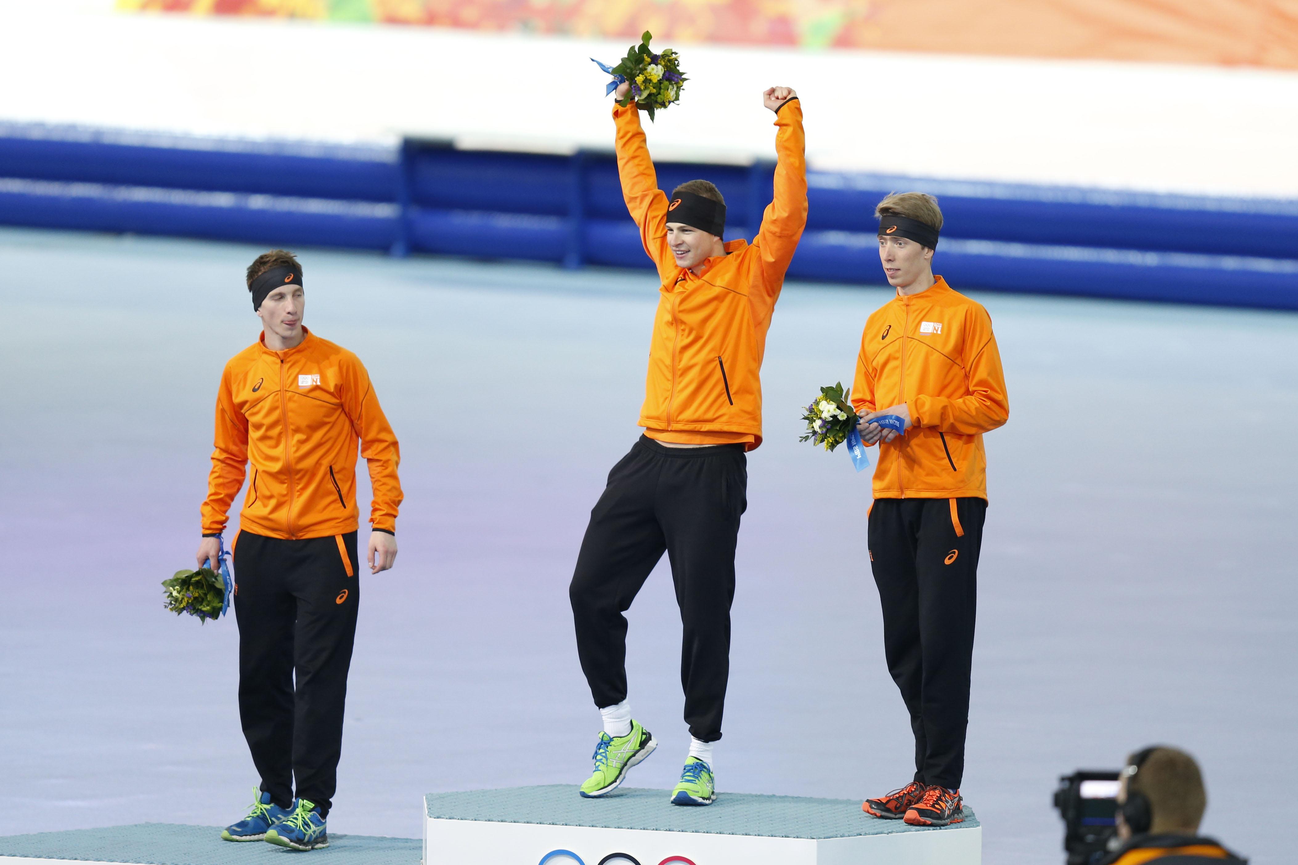 Sven Kramer, center, Jan Blokhuijsen, left, and Jorrit Bergsma, right, celebrate winning first, second, and third, respectively in the men's 5,000 meters during at Adler Arena Skating Center. (Jeff Swinger, USA TODAY Sports)